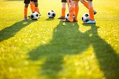 Boys Training Football On The Pitch. Soccer Football Training Session For Kids. Soccer Pitch On A Su poster