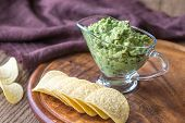 Guacamole With Chips On The Wooden Board poster