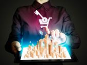 Woman Holds A Tablet Pc In Her Hands. Tablet Pc Has A Hologram With Real Estate For Sale. Concept Of poster