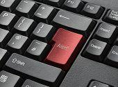 Red Key On Computer Keyboard Entitled Alert poster