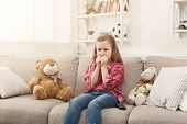 Scared Little Casual Girl Watching Tv. Frightened Female Kid Sitting On Sofa, Home Alone, Watching F poster