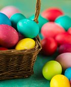 Multicolored Easter eggs on green background. Copyspace. Still life photo of lots of colorful easter poster