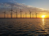 Floating On The Sea Wind Farm At Dusk poster
