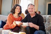 Portrait Of Middle Aged Couple Meeting In Coffee Shop poster