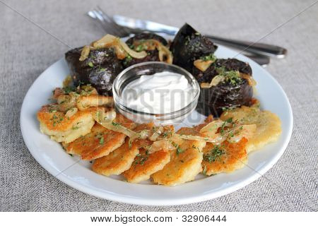 Potato pancakes with blood sausage and sour cream