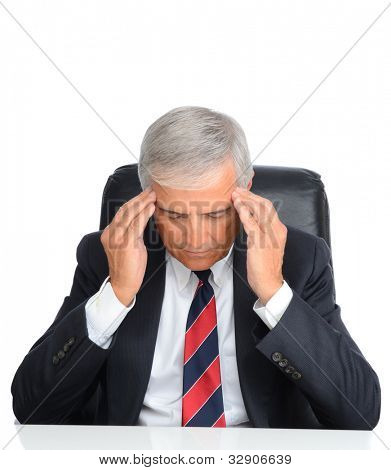 Mature businessman seated at his desk holding his temples to ease a migrane headache. Square format over a white background.
