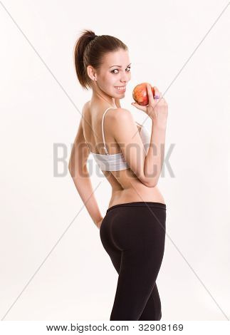 Cute Fitness Brunette With Red Apple.