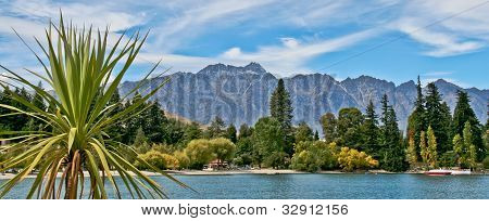 Panoramic view of mountains & water with palm tree