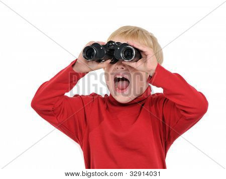 Happy boy with binoculars, isolated on white