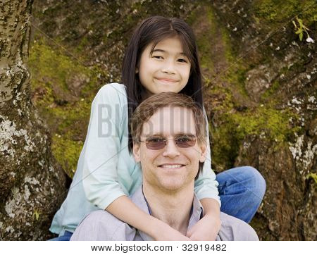 Little Girl Hugging Father Around Neck