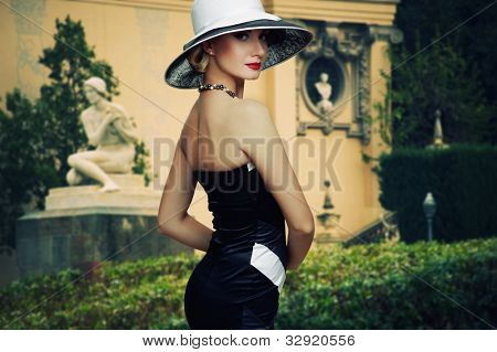 Beautiful woman in hat outdoors.