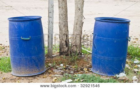 Two Trash Bins Outdoors