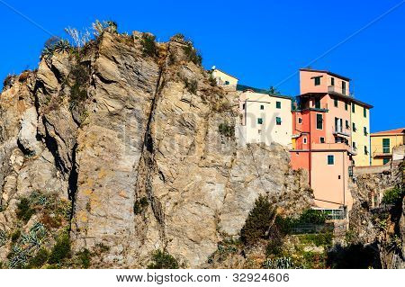 Houses High On The Cliff In The Village Of Corniglia, Cinque Terre, Italy