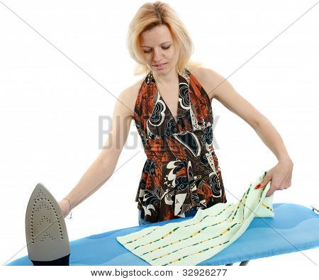 Beautiful Housewife Ironing The Laundry