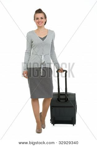 Happy Traveling Woman With Suitcase Making Step Forward