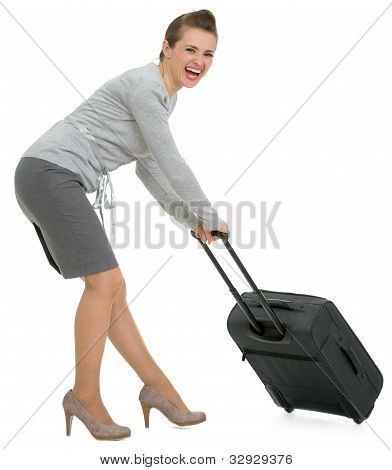 Tired Traveling Woman Hauling Suitcase