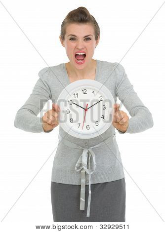 Stressed Business Woman Showing Clock