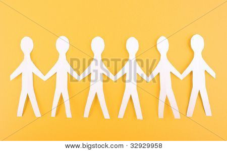 Paper people on orange background