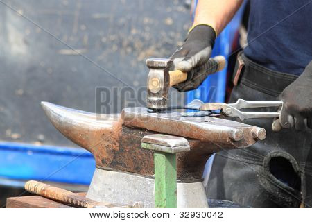 Farrier Making A Horseshoe