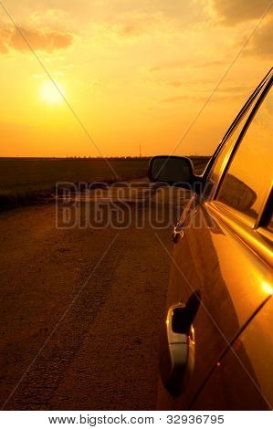 Side detail of a car in the sunset