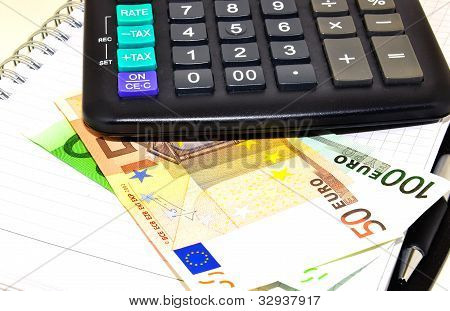 euro notes, calculator and note book
