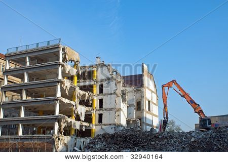 Demolition of a building with excavator