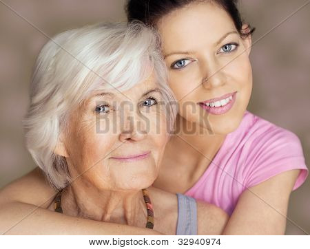 Grandmother and granddaughter portrait, embraced