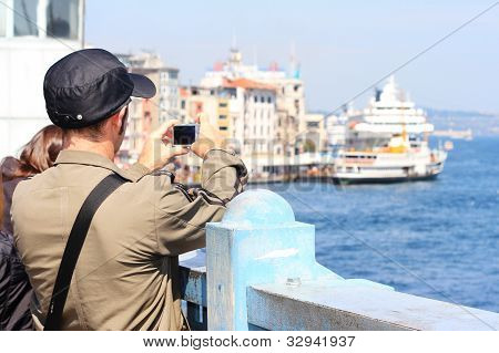 Man takes photo on the bridge