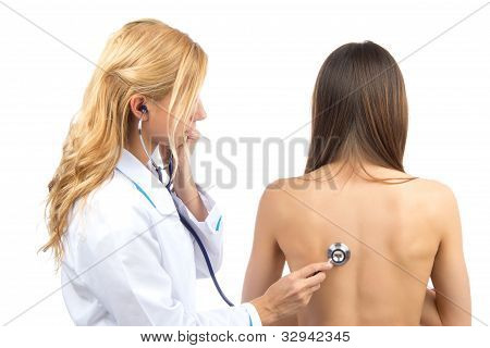 Doctor Or Nurse Auscultating Patient With Stethoscope