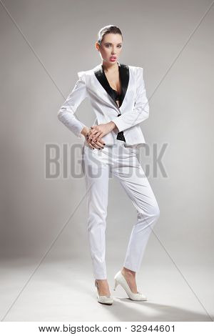 Sexy young woman wearing white suit