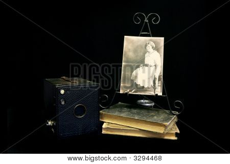 Vintage Photograph Next To An Old Antique Camera