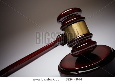 Wooden gavel, selective focus on metal part