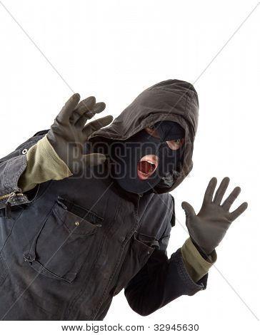 Surprised burglar in black mask