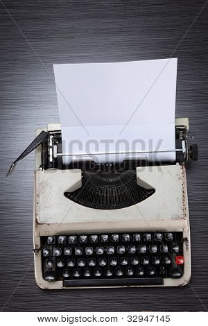 old-fashioned typewriter with paper