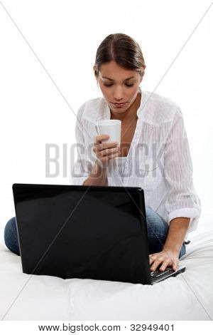 Woman with computer and coffee