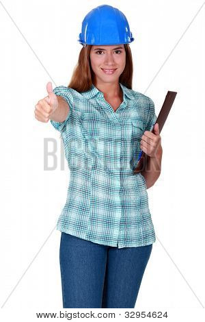 Woman in a hardhat with a clipboard