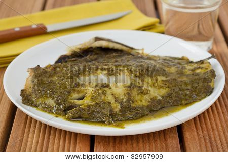 Fish With Sauce Pesto On Th Plate