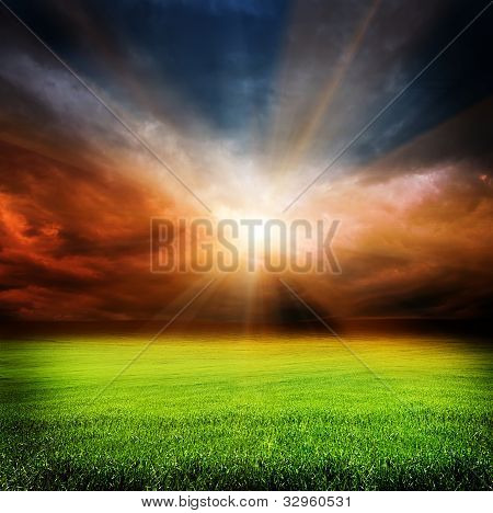 Dark Evening Sky And Green Field