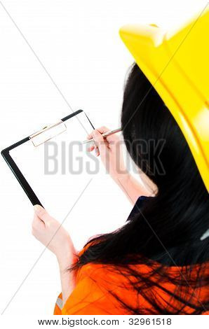 Engineer Woman  Taking Notes In Her Clipboard