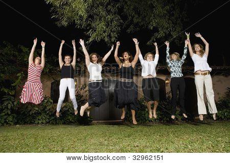 Group of Hispanic women jumping