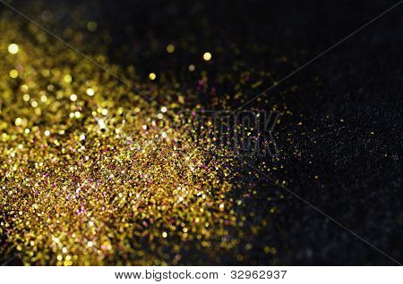 Gold Glitter On Black Background