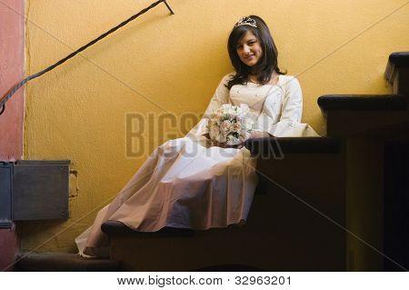 Hispanic girl in Quinceanera dress