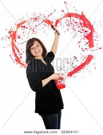 A beautiful young teen flinging paint behind her, creating a splattered red heart.  On a white background.