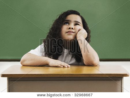 African girl sitting at school desk