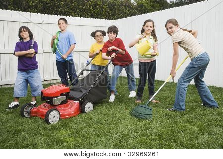 Multi-ethnic children doing yard work