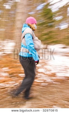 Young Woman Hike In Forest With Baby