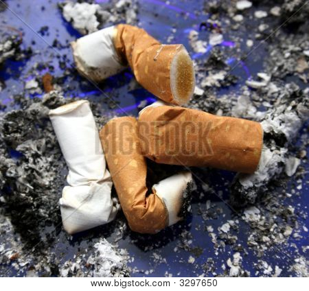 Cigarettes In A Dirty Ashtray