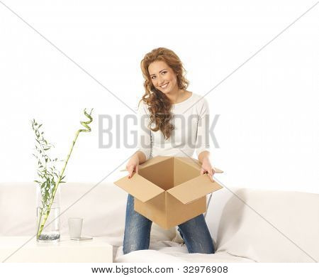 Young attractive woman with a parcel in modern interior
