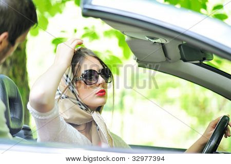 Man approaching to a woman in a car
