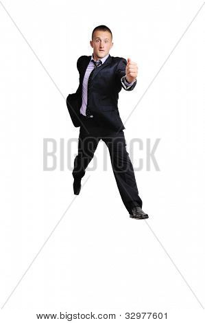 Full length of business man with briefcase running on white background